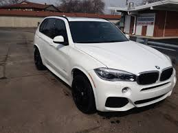 bmw x5 rims black style 215 gloss black wheels fitted on alpine white f15