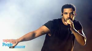drake got a tattoo of lil wayne u0027s face on his arm people com