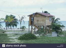 belize placencia beach wooden house building on stilts belize placencia beach wooden house building on stilts central america destination beach house timber frame construction way raised cross flag