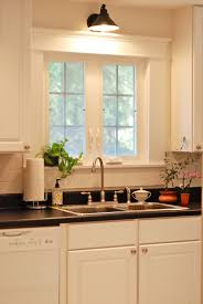 Kitchen Sink Light Sconces In The Kitchen Sinks Clocks And Kitchens