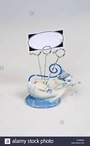 blue and white cat ornament with business card holders against a