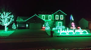 pictures of christmas lights on houses green christmas lights galore this christmas lights house is as