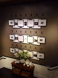overlapping picture frames hanging from hooks pottery barn
