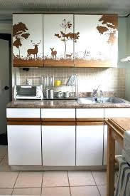 vinyl paper for kitchen cabinets how to cover kitchen cabinets with vinyl paper kitchen cabinets