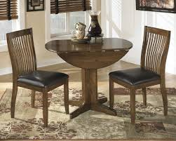 round drop leaf table set stuman round drop leaf table d293 15 tables rogers furniture