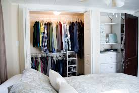 closet ideas for small spaces white closet bedroom with doors near bed and pillows simple walk