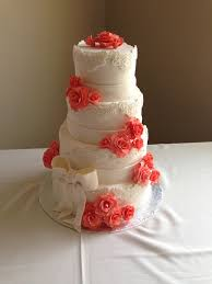 coral wedding cakes white wedding cake with coral flowers a outdoor wedding