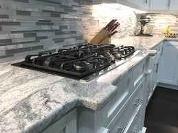 gray kitchen cabinets with white granite viscon white granite