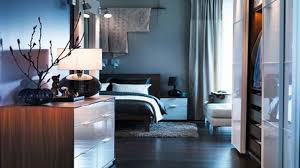 outstanding ocean blue bedroom wall colors with oak wood bed