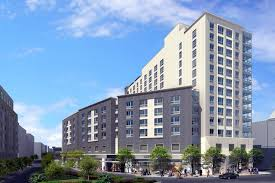 construction wraps on 14 story 159 unit affordable mixed use