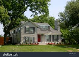 colonial style house extremely red front stock photo 1293211