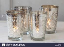 silver tea light holders group of 4 silver tea light holders with tea lights alight inside