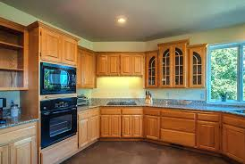 what color countertops with honey oak cabinets honey oak cabinets with black granite countertops kitchen