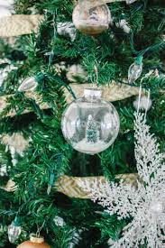 diy snow globe ornament fill a clear ornament with a bottle