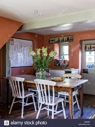 windsor chairs around a french farmhouse table in country kitchen
