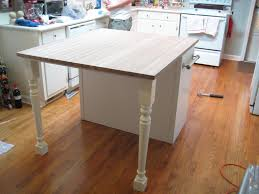 luxury white kitchen island with butcher block top taste