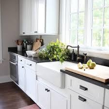 white kitchen cabinets soapstone countertops ts soapstone counters white cabinets black hardware jen