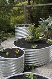 Galvanized Trough Planter by Remodelaholic 30 Raised Garden Bed Ideas
