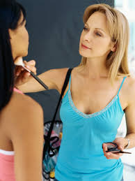 makeup artist applying cosmetics