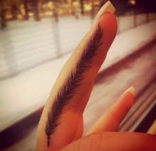 feather finger tattoo possibly to cover up something i already