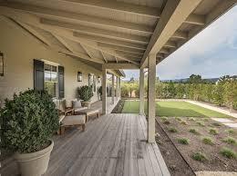 wrap around porch ideas napa valley farmhouse with neutral interiors interior for