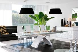 modern glass top dining table with white elegant chairs and