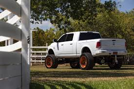 Dodge Ram Trucks With Rims - lifted ram 2500 on rose gold wheels meets a horse autoevolution