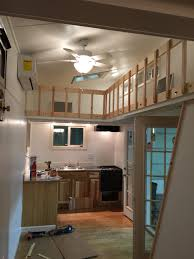 white interior tiny house tiny home with lofts and catwalk built