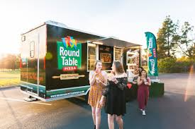 call round table pizza round table pizza on wheels pizza truck serving pizza on demand