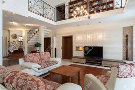 classy home interiors classy house elegant living room and a mezzanine stock photo