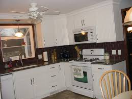 tiles backsplash off white cabinets with granite countertops