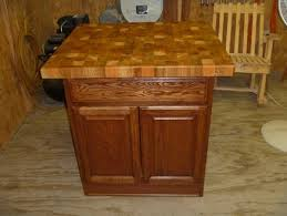 kitchen island with a butcher block top by knifelife