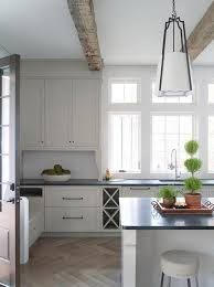 Kitchen Shaker Cabinets by Beautiful Kitchen Boasts Rustic Wood Ceiling Beams Over Off White