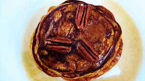 pumpkin pancakes with cinnamon maple syrup peanut butter and peppers