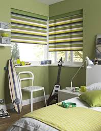 boys bedroom with sage green walls and stripes window blinds the