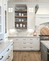 how to paint stained kitchen cabinets our best tips for staining cabinets or re staining