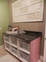 Laundry Room Table With Storage The Laundry Room And A Laundry Folding Table With Basket