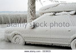 severe winter frozen car trapped ice versoix canton