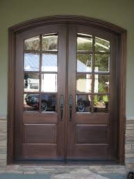 Metal Front Doors For Homes With Glass by Transparent Double Glass Front Doors With Dark Brown Wooden Frames