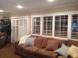 Shutters On A Slider And Living Room Window Modern Family Room - Family room window treatments