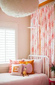 pink bedroom with play nook with pink curtains contemporary