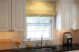 bay window kitchen nook arched frame windows orange shade pendant