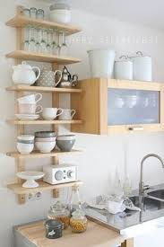 Open Kitchen Shelves Instead Of Cabinets Line The Back Of Your Kitchen Cabinets With Fabric And Thumbtacks
