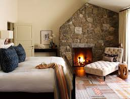 fireplace bedroom cottage guest bedroom with laminate floors by david scott zillow