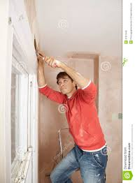 man scraping paint off wall stock photo image 31827942
