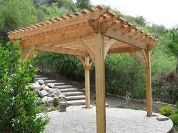 adding shade with a natural finish timber frame pergola kit