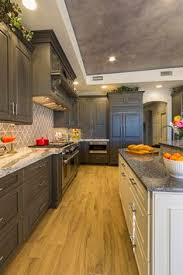 Frameless Kitchen Cabinets Manufacturers by Frameless Kitchen Cabinets With Portsmouth Door Style In Knotty