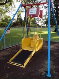 handicap swing file wheelchair playground swing jpg wikimedia commons