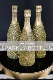 how to decorate a wine bottle for a gift go for the gold with these diy sparkly bottles evite