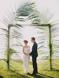 wedding arch leaves intimate sayulita wedding oliver backdrops palm and wedding